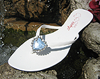 White comfortable flip flops with Rhinestone Hear.  Great for Brides.